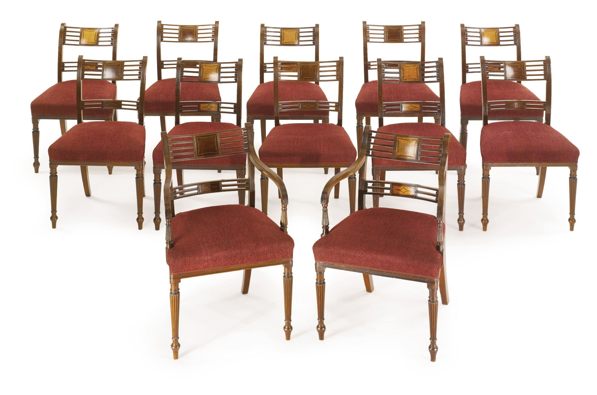 A set of twelve Regency inlaid mahogany and satinwood dining chairs circa 1810
