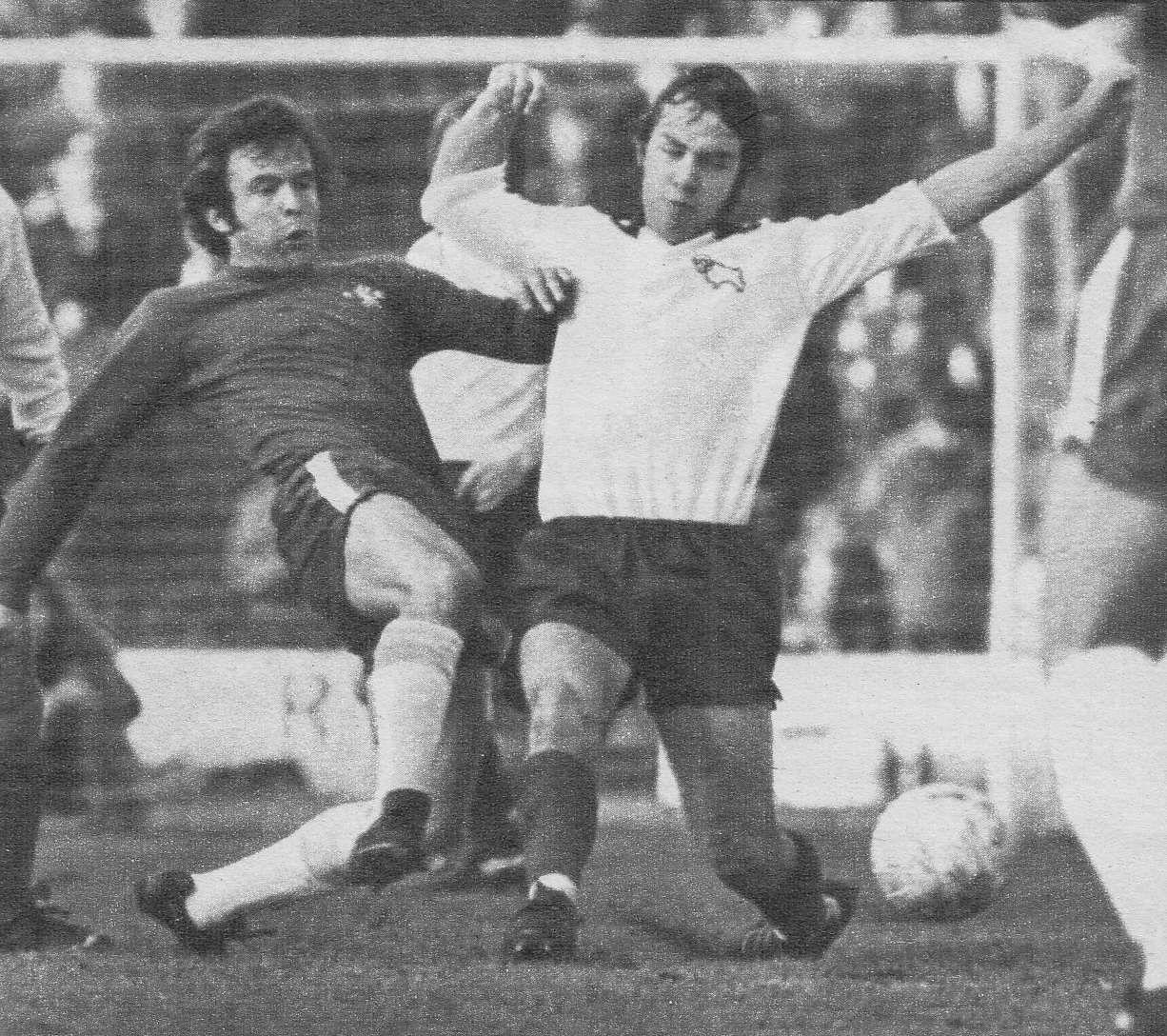 19th January 1974. Chelsea midfielder John Hollins tackle Derby ...