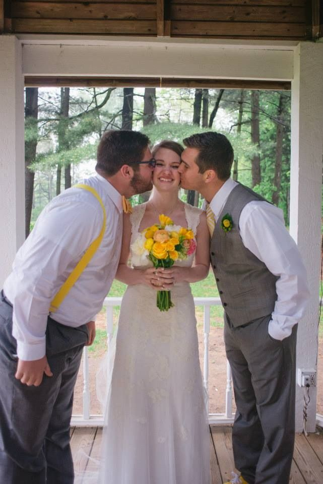Cute pose for a bride and her brothers on the wedding day Must