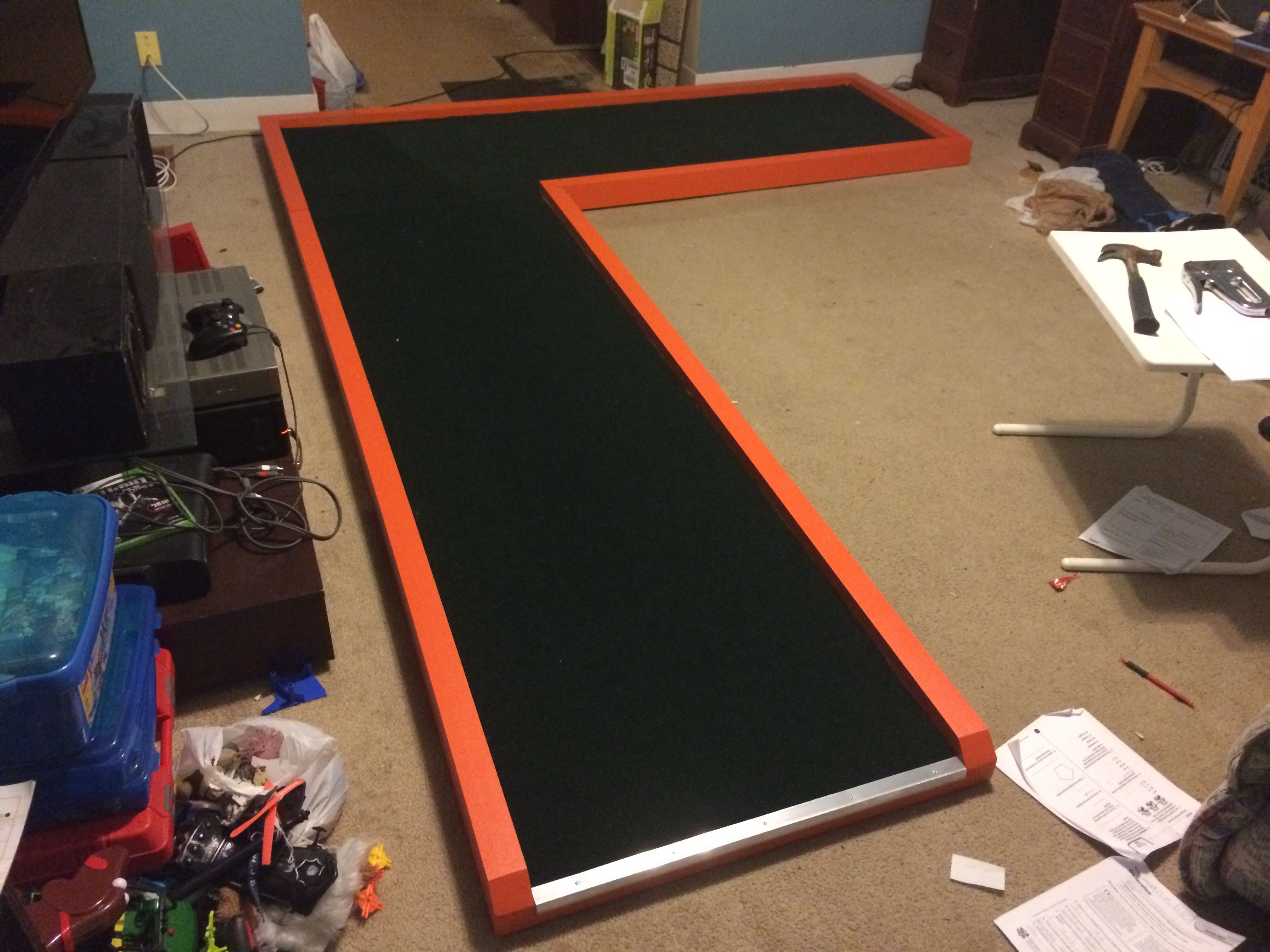 """This is a tutorial someone put together on how they built their own """"L"""" shaped indoor miniature golf hole."""