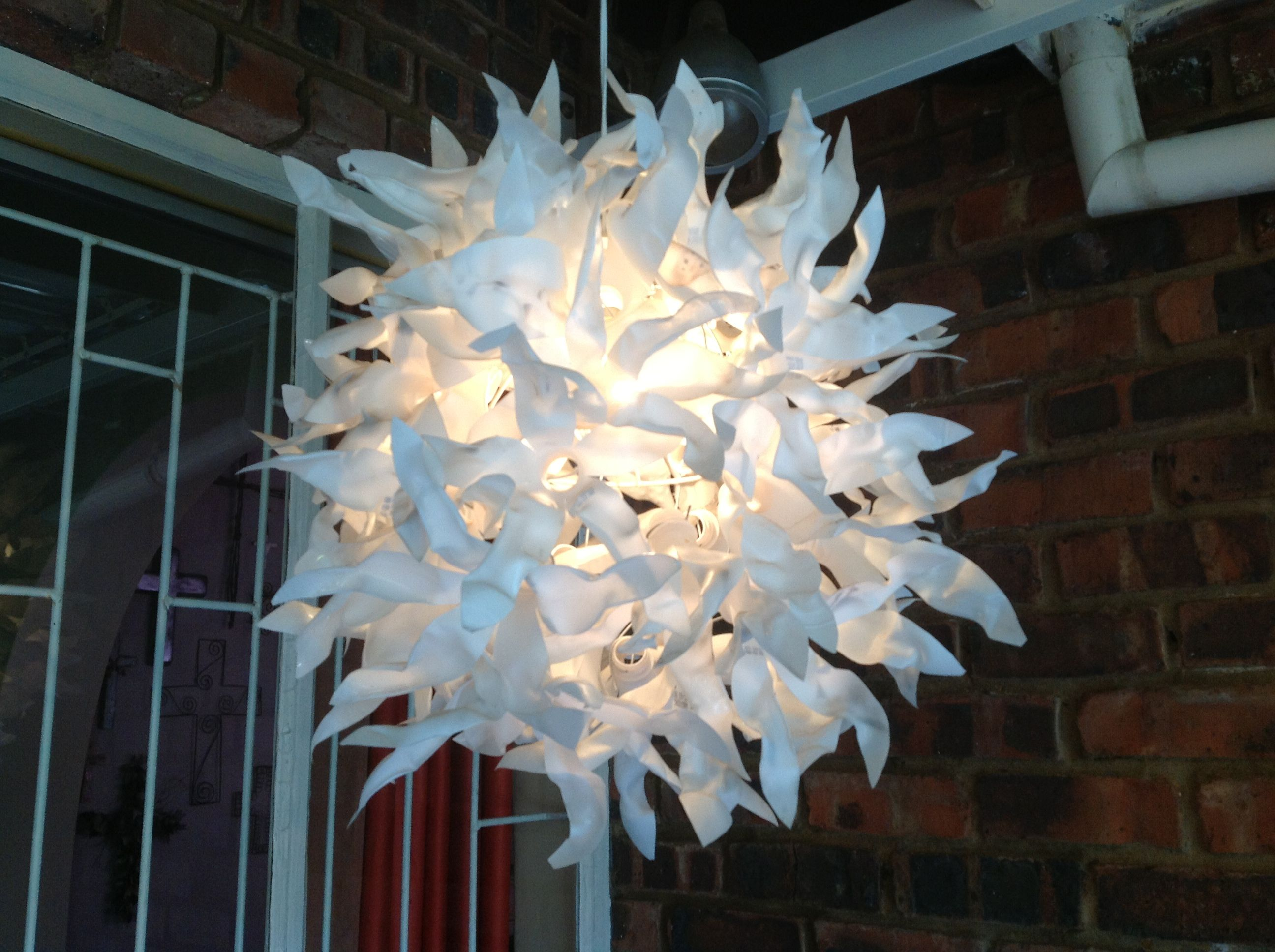 Homemade chandelier from recycled coke bottles want to order recycled plastic pop bottles converted into chandelier arubaitofo Images