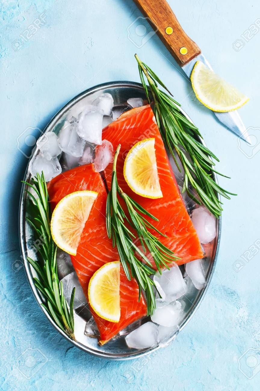 raw salmon with lemon on a table Stock Photo ,