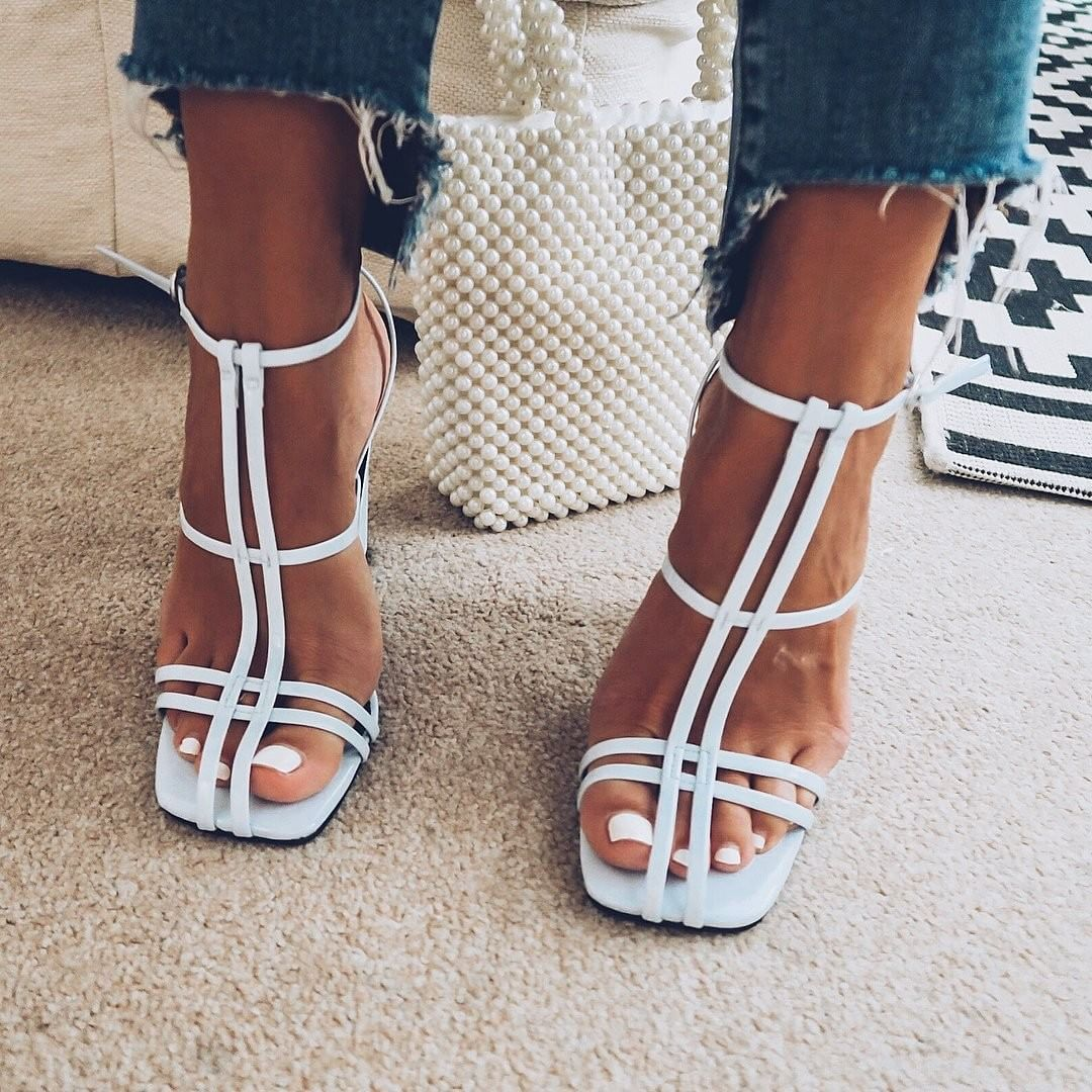 624146fa47f5b4 Who said summer sandal season is over  👡 Upgrade your footwear collection  with these ultra-fashion blue cage block heel sandals with retro shaped  heel.