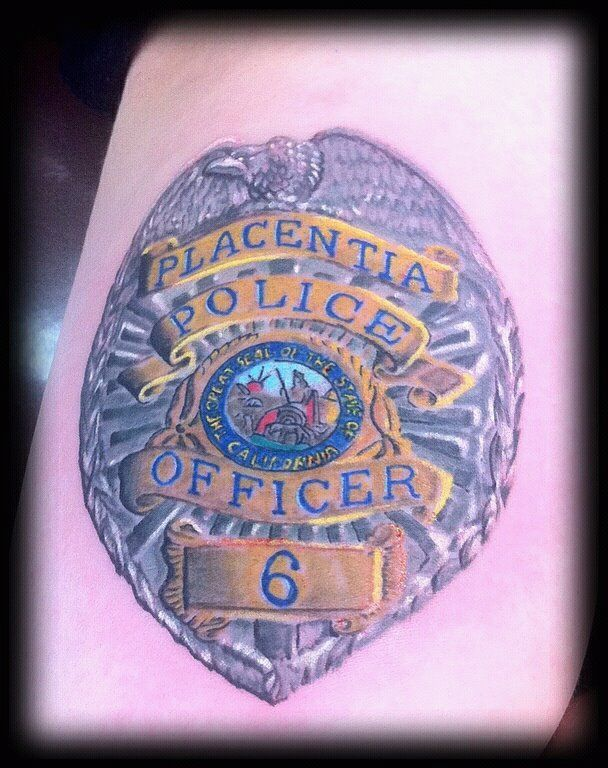 Police badge memorial tattoo rebirth tattoo by vinnie for Law enforcement memorial tattoo