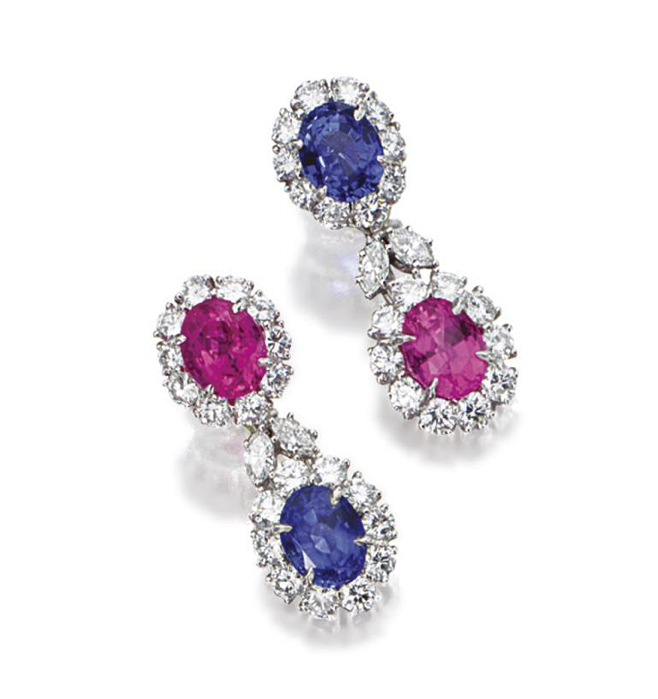 PAIR OF PINK AND BLUE SAPPHIRE AND DIAMOND PENDANT-EARCLIPS, HARRY WINSTON. The tops set with an oval pink sapphire weighing 3.27 carats and an oval blue sapphire weighing 4.00 carats, supporting pendants set with an oval pink sapphire weighing 3.19 carats and an oval blue sapphire weighing 4.06 carats, all framed by 40 round diamonds and connected by pairs of marquise-shaped diamonds weighing a total of approximately 5.25 carats, mounted in platinum, pendants detachable, signed Winston.