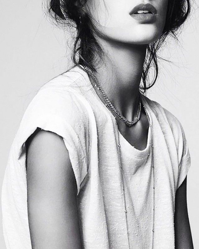 We love the effect of layering delicate necklaces on a simple white T.