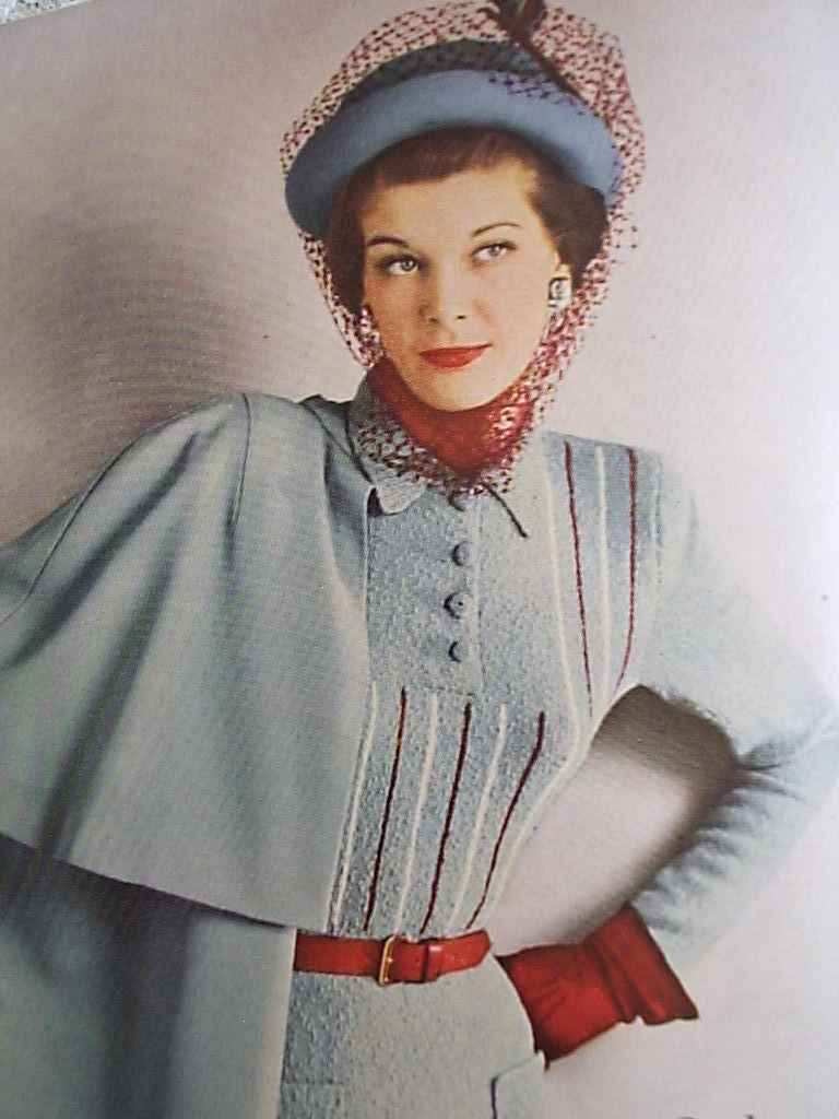 1940's fashion: knitted dress with cape sleeves, hat and gloves