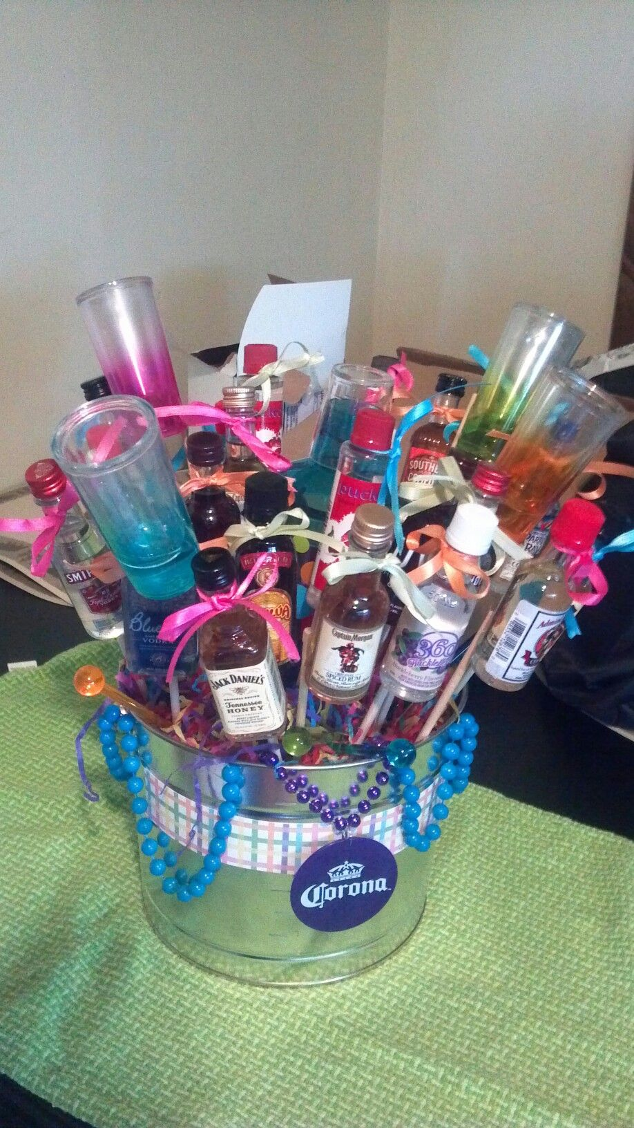 like the metal bucket fat tuesday theme or margarita ville liquor basket