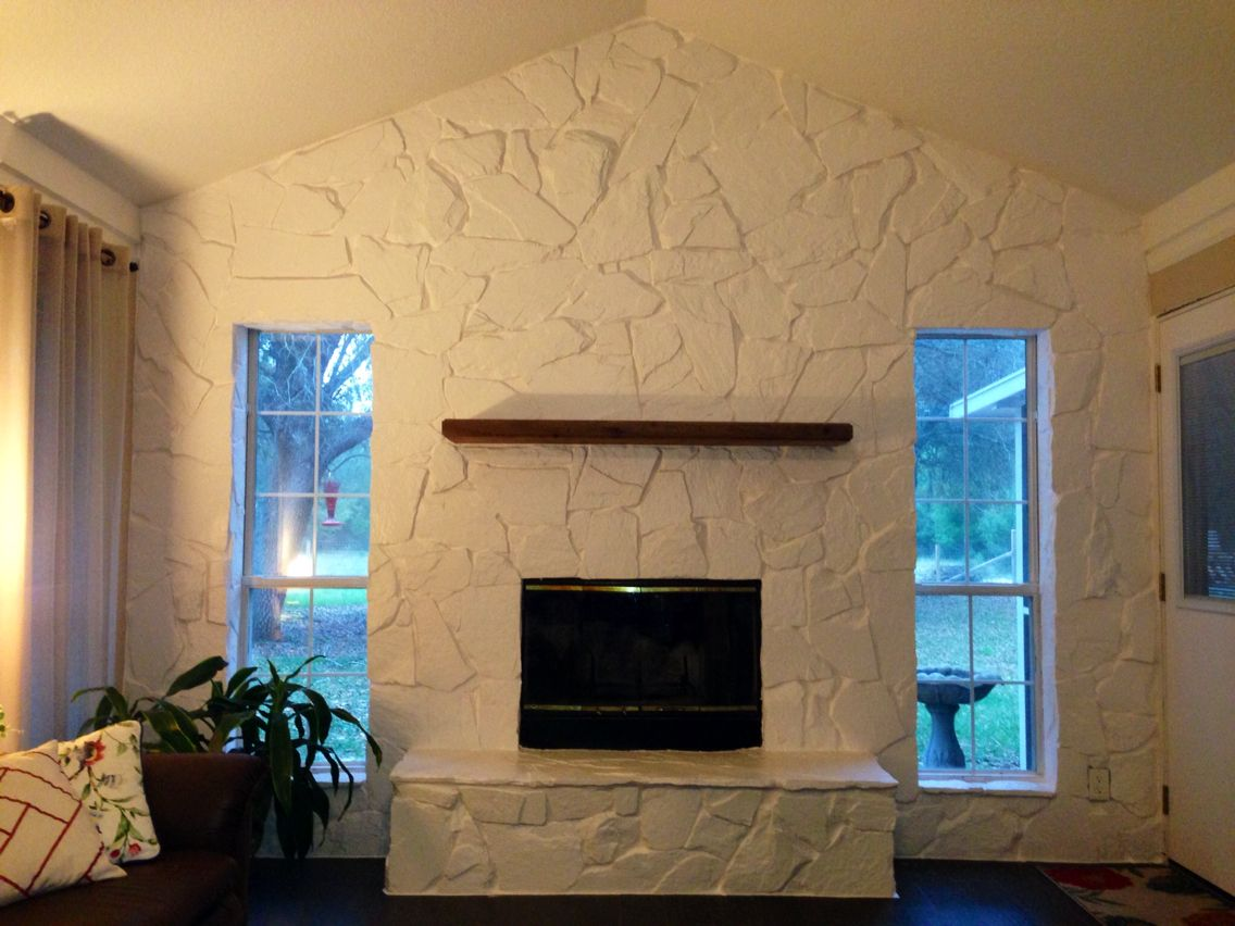 Update Your Dated, Dark Stone Wall With A Fresh Coat Of White Paint. I