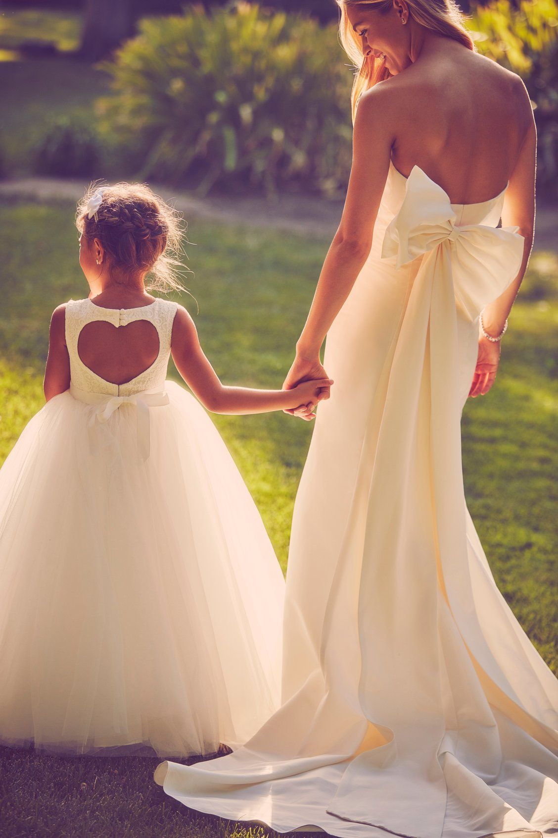 1a11f4308 Unexpected back details from the bride to the flower girl. These ...