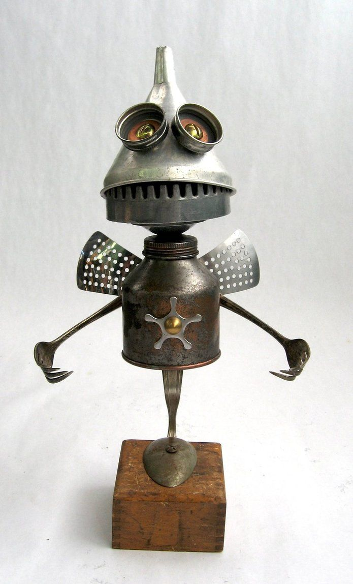 Robot sculpture assembled from found objects by Brian ...