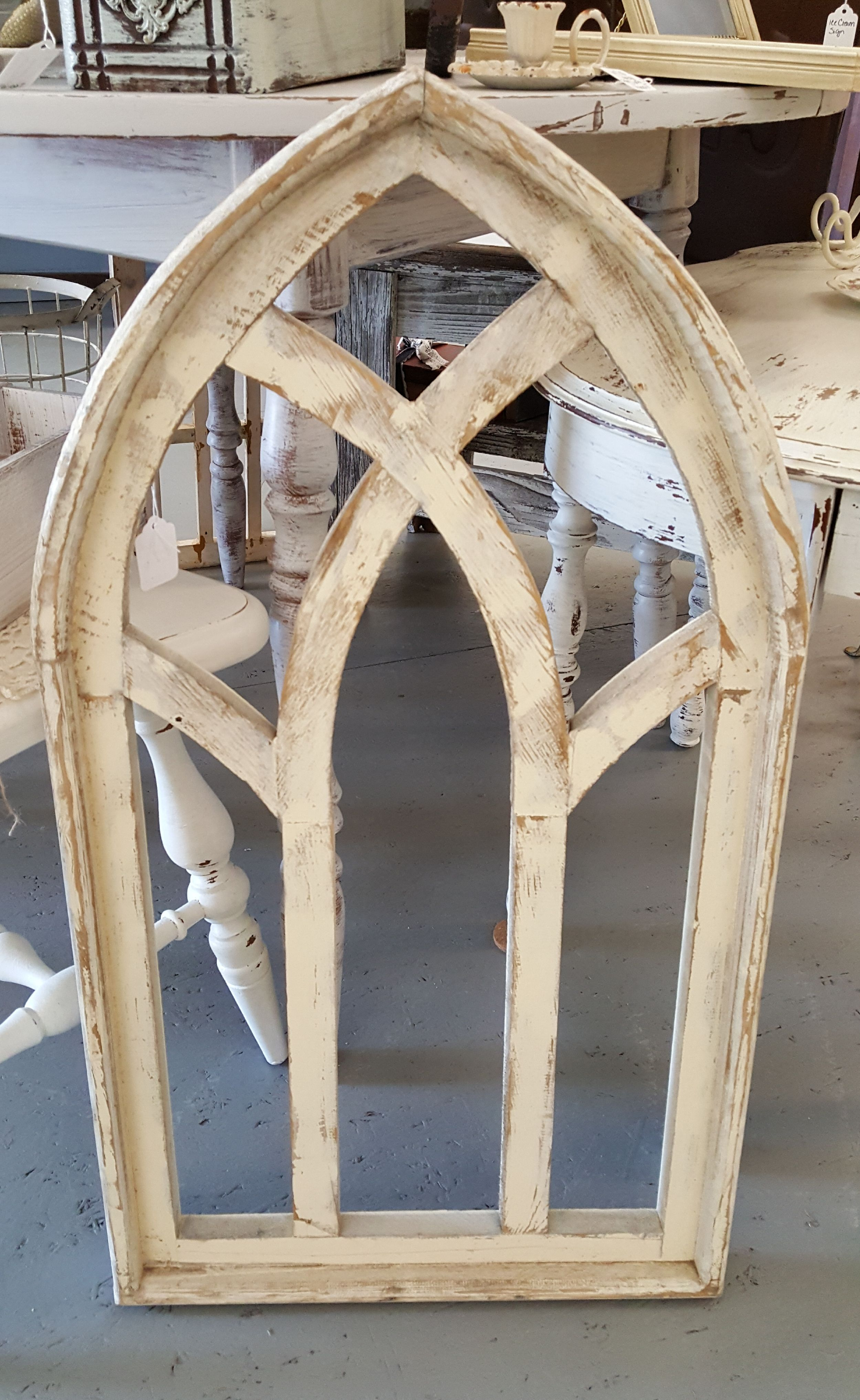 Cathedral wood window. Fixer upper style. White distressed