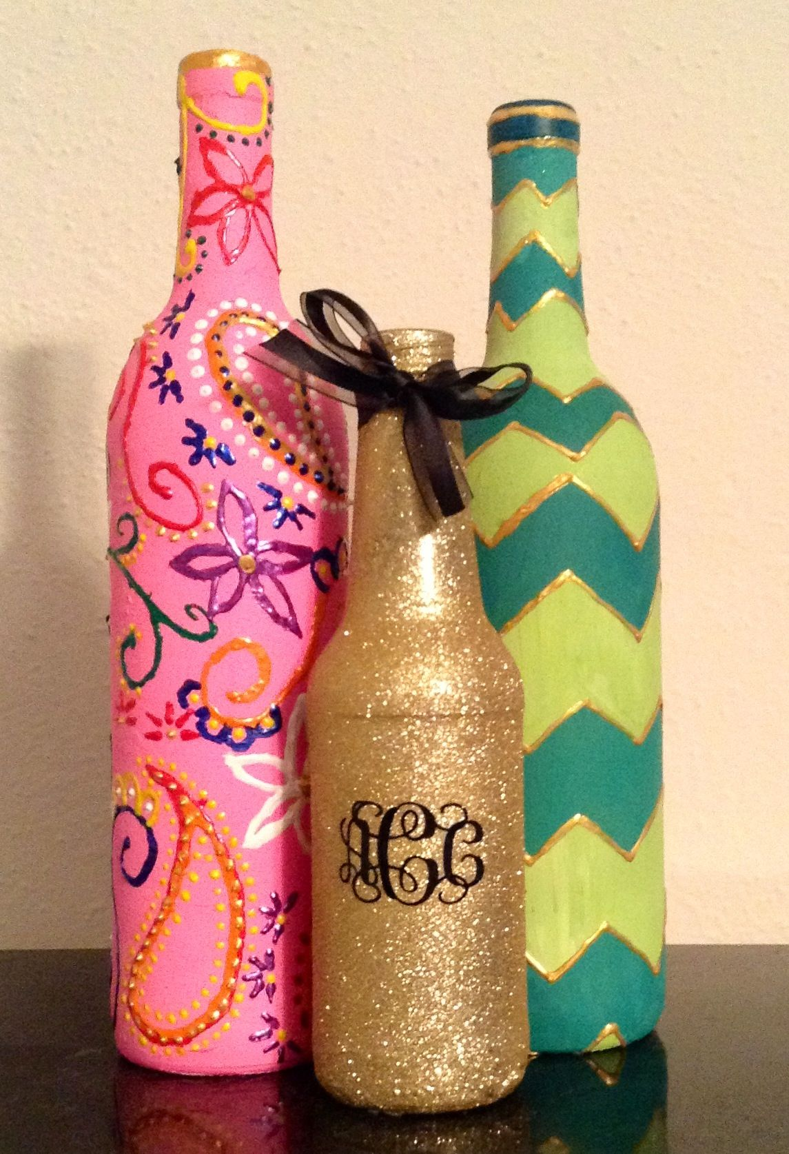 DIY Painted wine bottles. Floral, glitter monogram, and