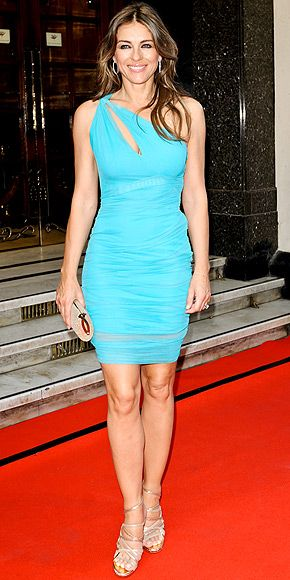 ELIZABETH HURLEY She my be pushing 50, but that doesn't stop Liz from showing off what she's got in an itty-bitty turquoise mini, complete with an asymmetrical slash cutout at the Brits Icon Awards in London. And really, can you blame her?