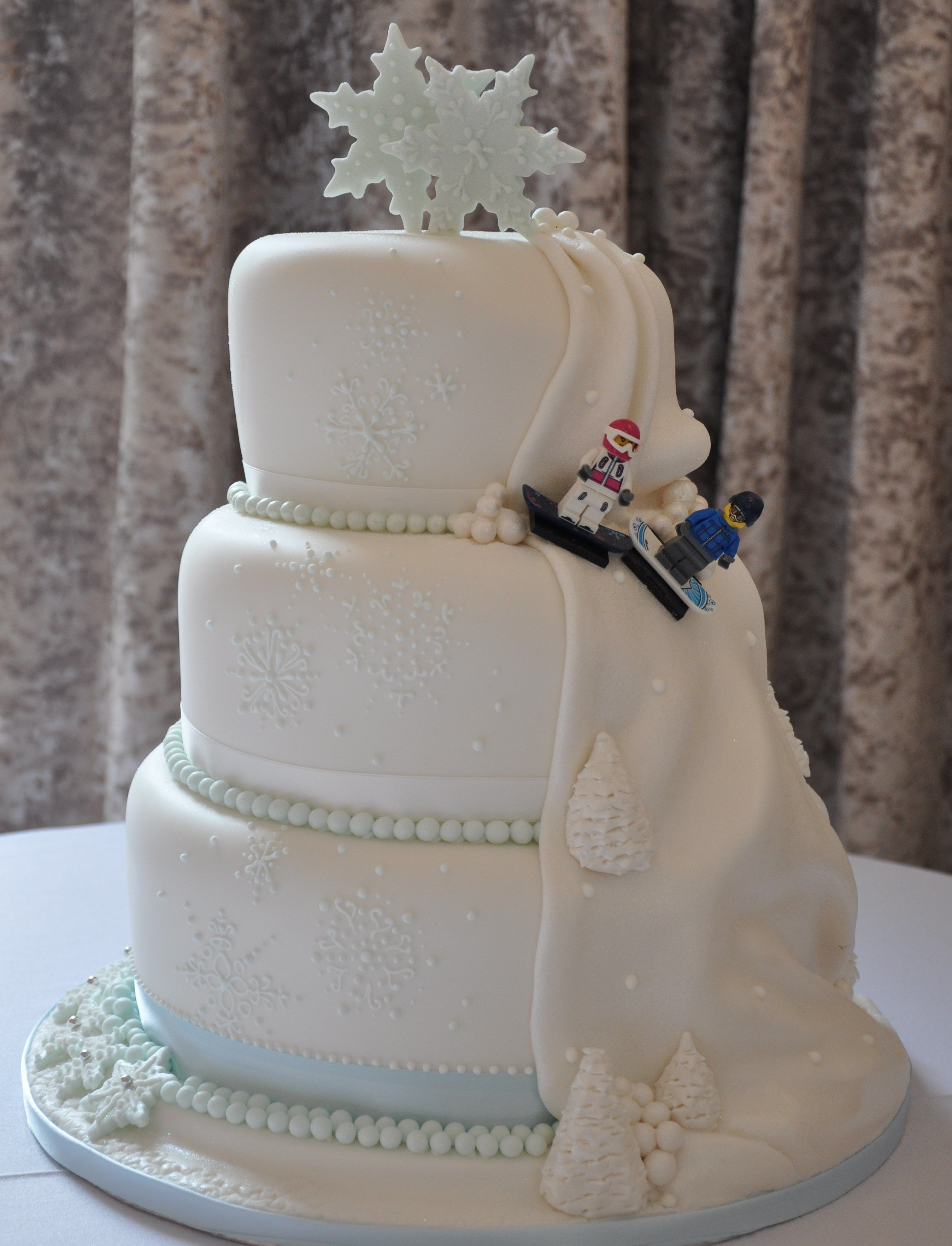 Winter Themed Wedding Cake With Piped Snowflakes And Snowflakes