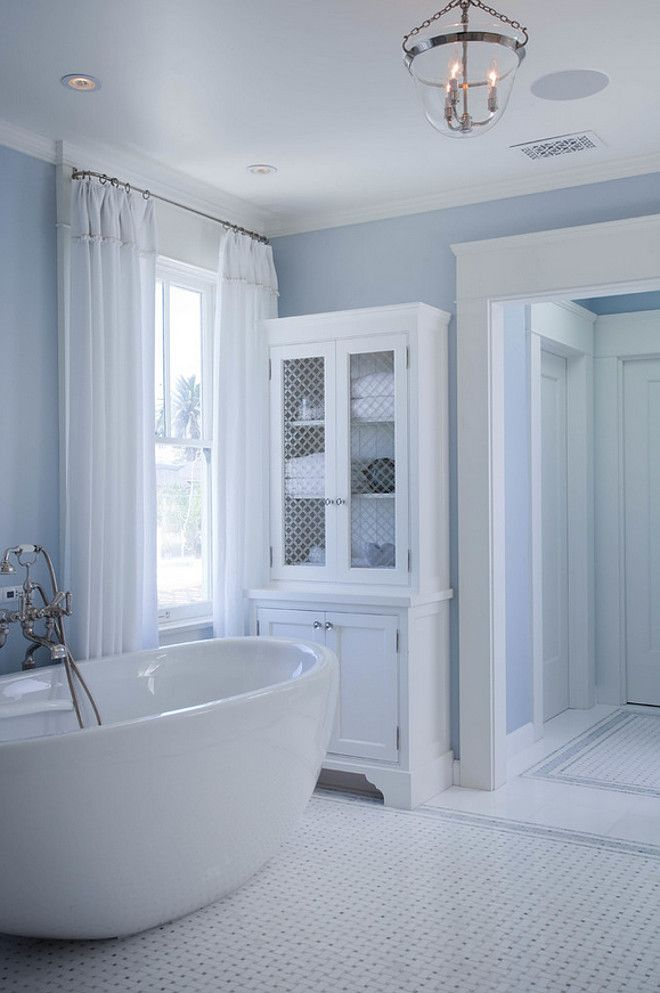 Bathroom Chicken wire cabinet doors. Blue and white bathroom with ...