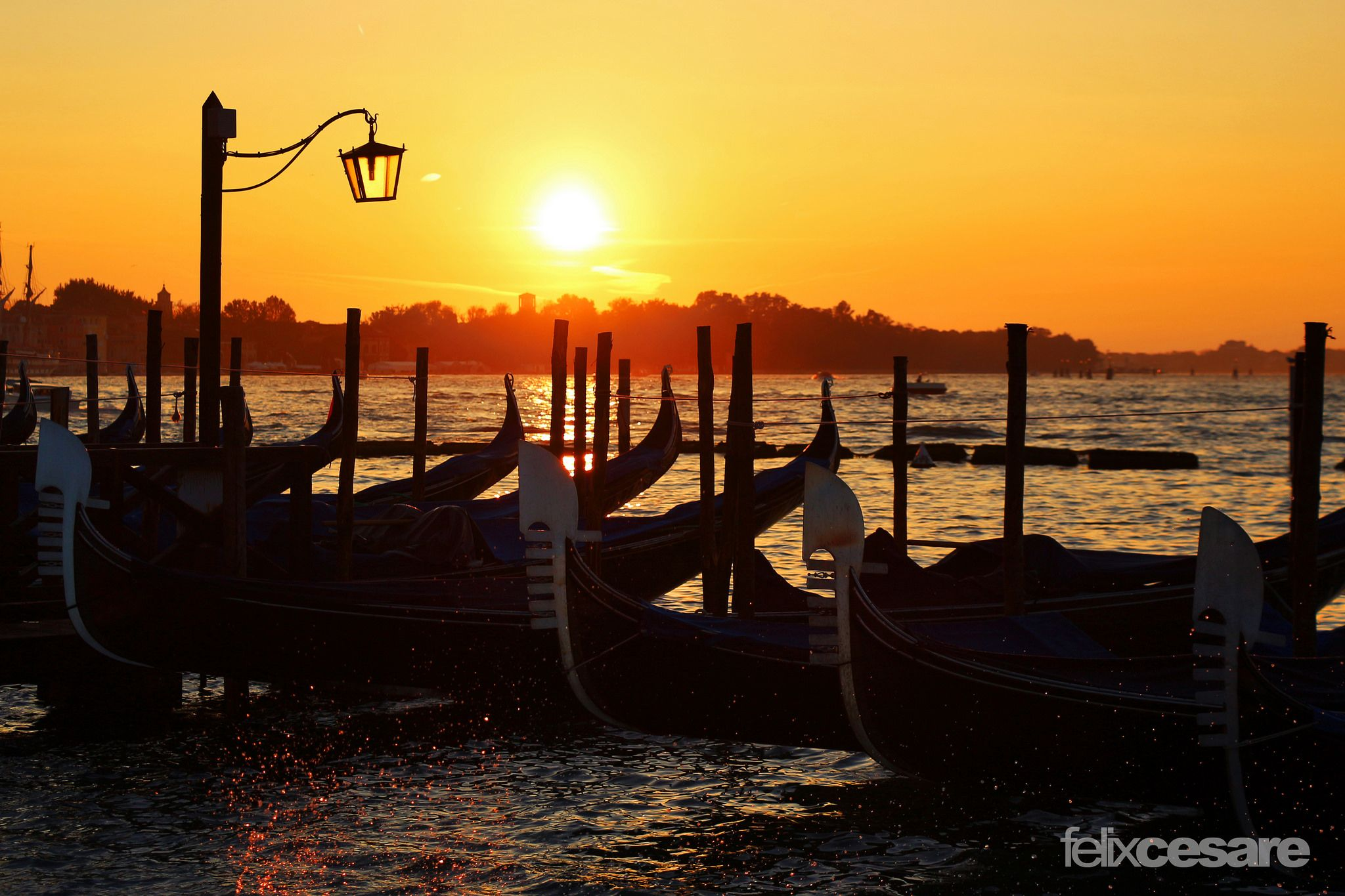 https://flic.kr/p/zBPFQg | Gondola Sunset, Venice | Venice is a city in northeastern Italy sited on a group of 118 small islands separated by canals and linked by bridges.