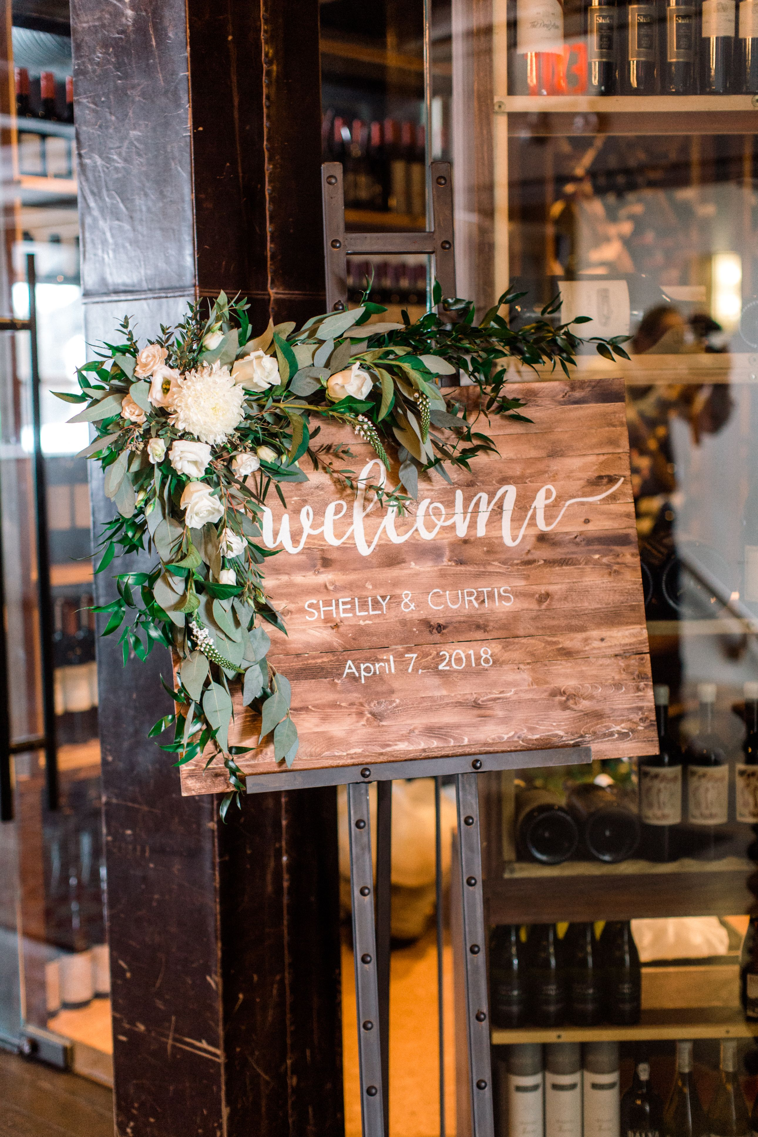 Wooden Wedding Welcome Sign With A Corner Floral Garland Of Italian Ruscus Silver Dollar Eucalyptus Whi Italian Wedding Themes Floral Garland Wedding Welcome