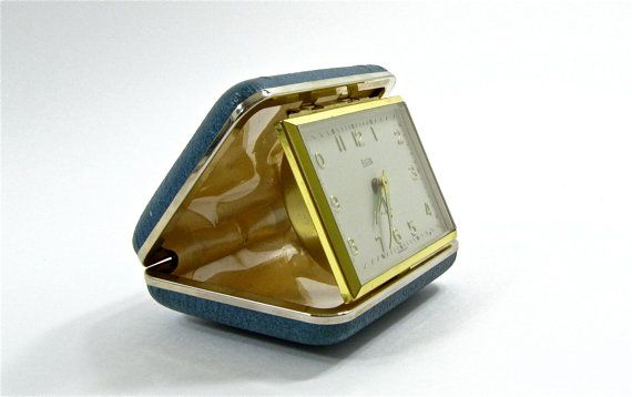 Before the days of alarms or cell phones there were travel alarm clocks. My dad had a brown one.