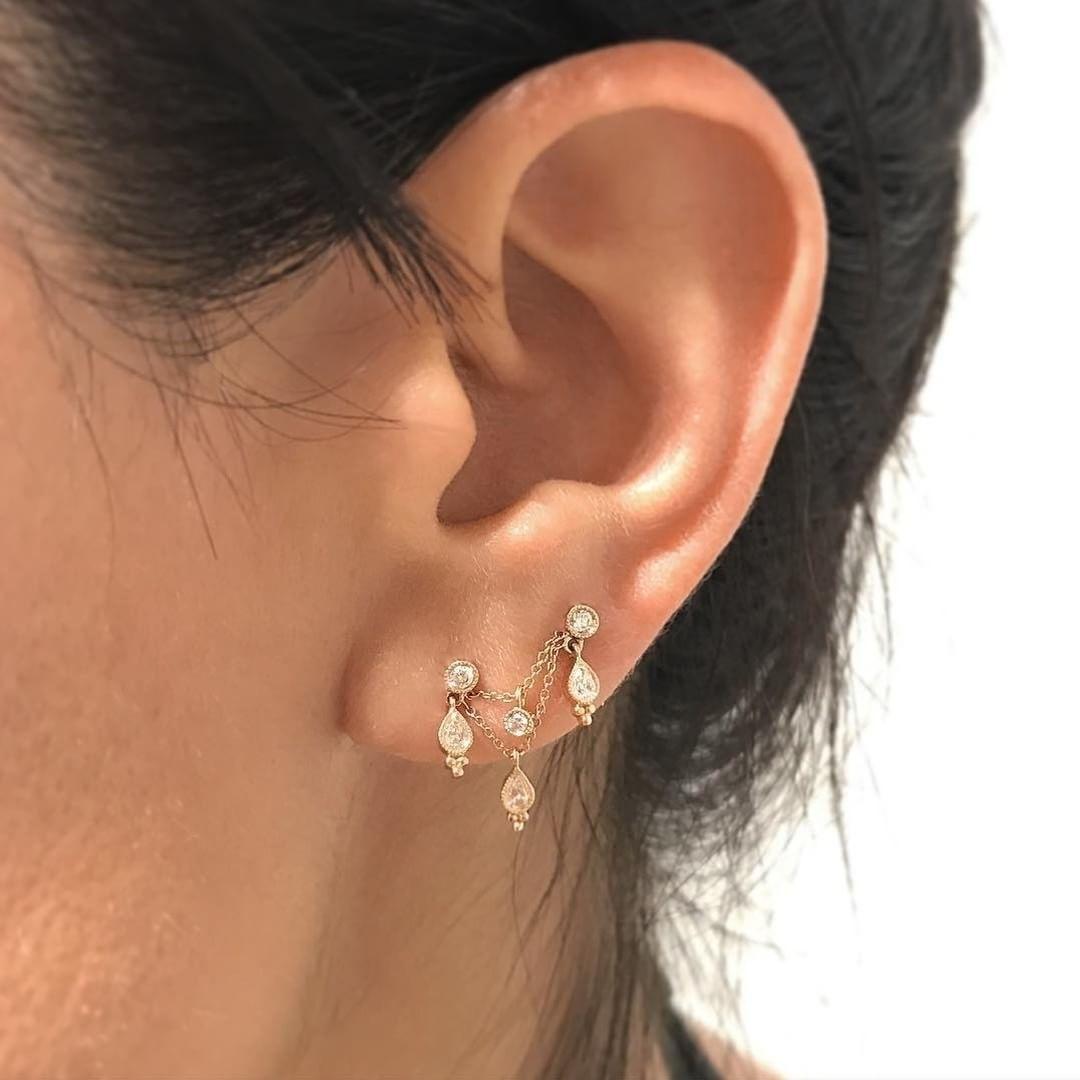 Orbital piercing ideas  Diamond Scalloped Round and Pear Trinity Orbital  Shop this