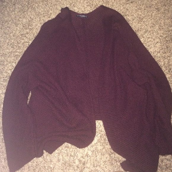 Brandy Melville Burgundy Cardigan New!! Don't like the way it looks on me so I never wear it! Very pretty deep burgundy color. Looser fit cardigan! Brandy Melville Sweaters Cardigans