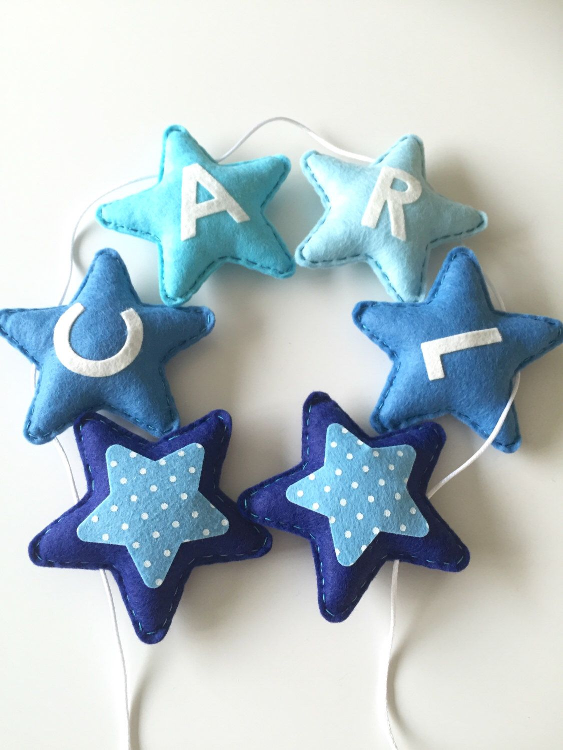 Personalised bunting garland , Blue Stars, baby boy nursery decoration, blue garland, boys name bunting, star garland, blue bunting by xCrazyLittleCraftsx on Etsy https://www.etsy.com/uk/listing/256970085/personalised-bunting-garland-blue-stars