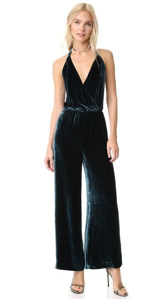 ef3df7427c9 A crushed velvet Free People jumpsuit with a daring lace-up back. Wide-leg  profile with cropped trousers. Halter neckline. Covered elastic waist.