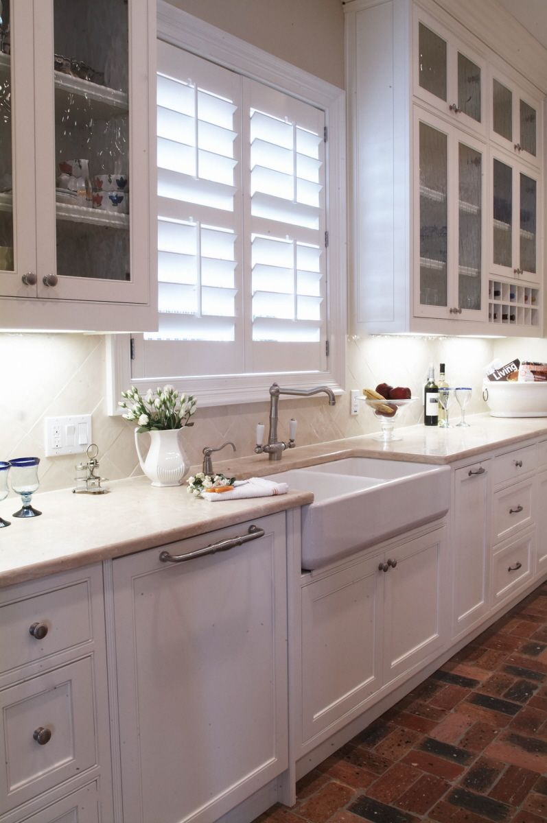 Farm Sink & White Kitchen. Love The Glass Cupboards Too
