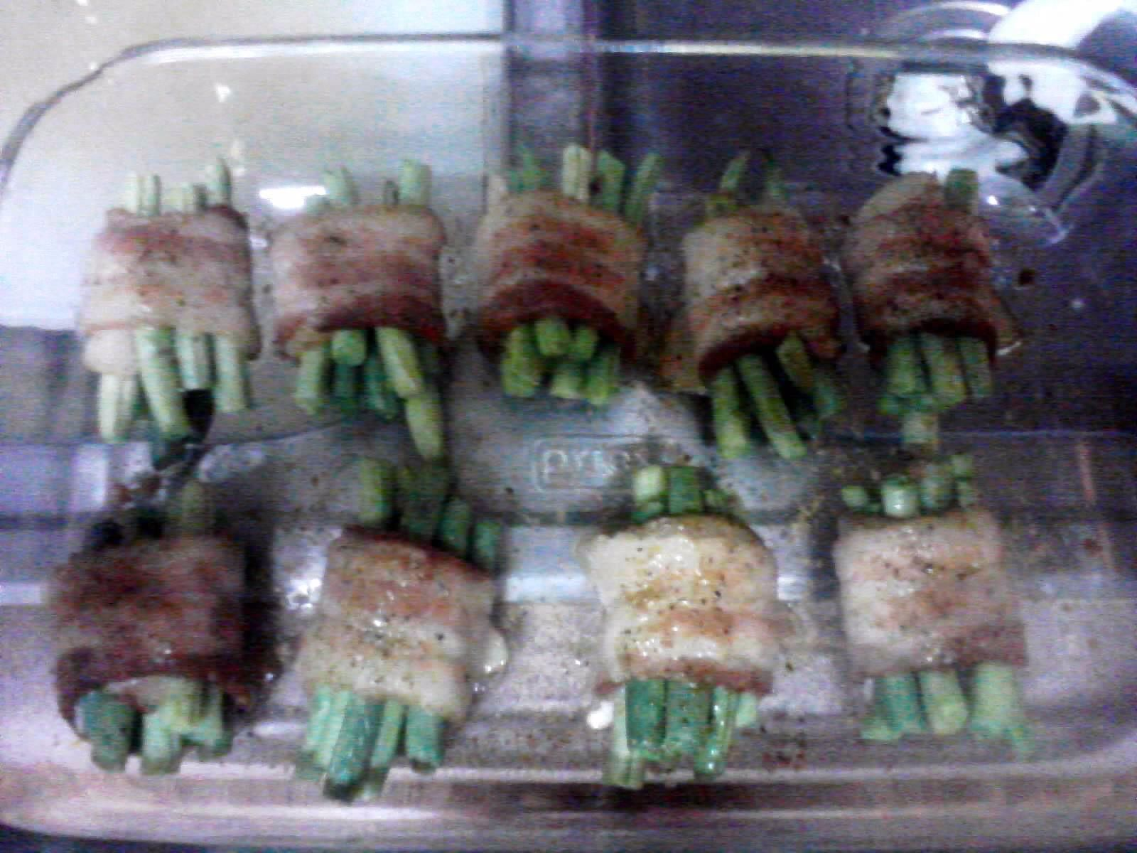 sinful green beans. cut green beans in half and cut bacon in half. wrap green beans with bacon and than sprinkle with brown suger and pepper. Bake at 400 for 20 mins.