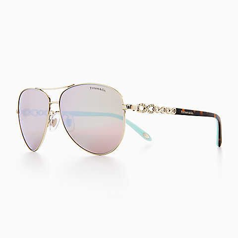 76cf9755ff3d8 Tiffany Infinity aviator sunglasses in pale gold-colored metal and acetate.