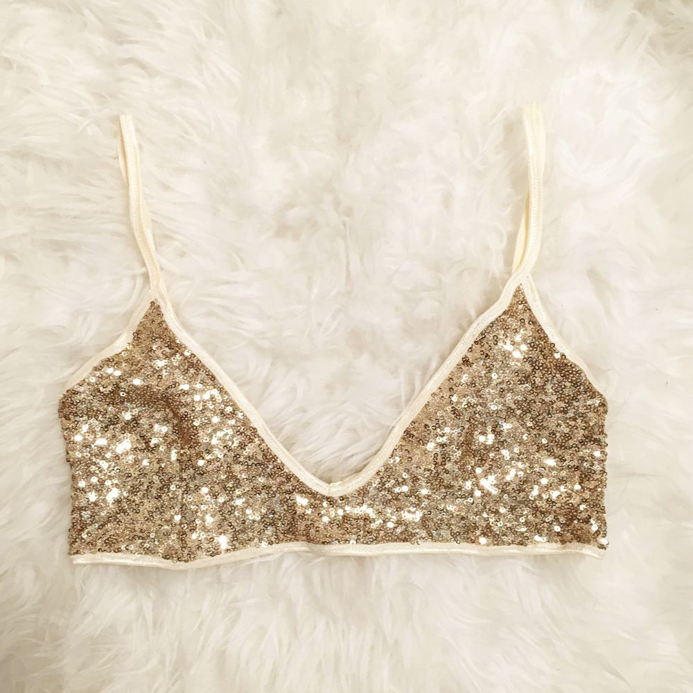 3ce1f41d955a78 Light up the night in this glamorous bralette. Semi-sheer gold ...