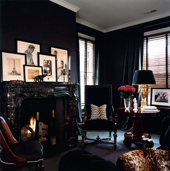love the white ceilings and dark walls. really love the art above the hearth.