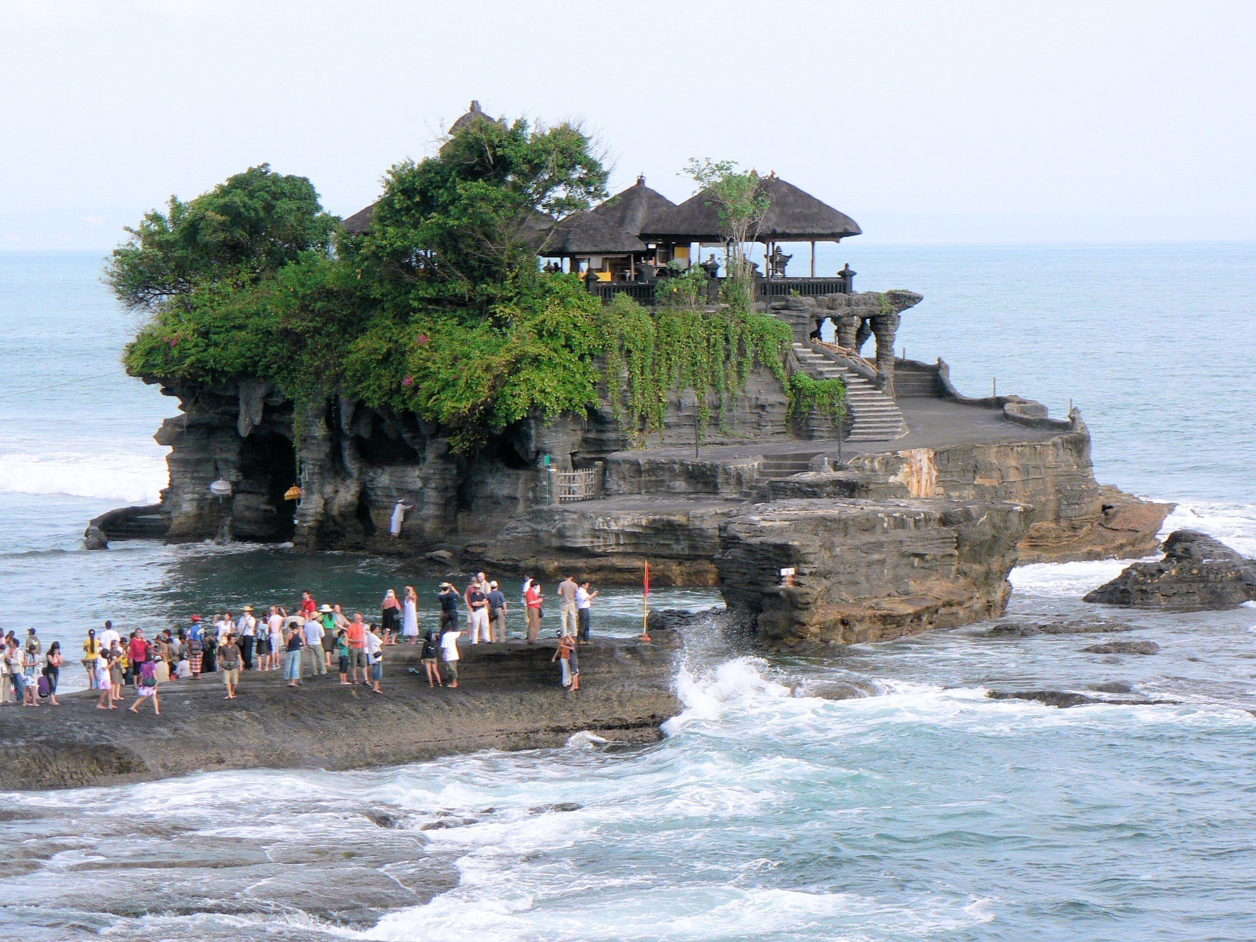 Royalty Free Photo Group Of People On Rock Beside Body Of Water Bali Temple Tanah Lot Sea Beach Built Structure Pariwisata Pemandangan Bali