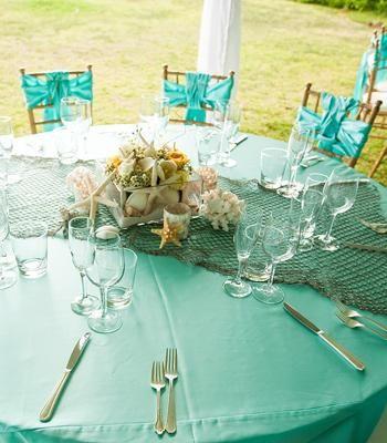 Beach wedding decor: Fishnets, seashells, starfish, and roses   Photo by Choco Studio