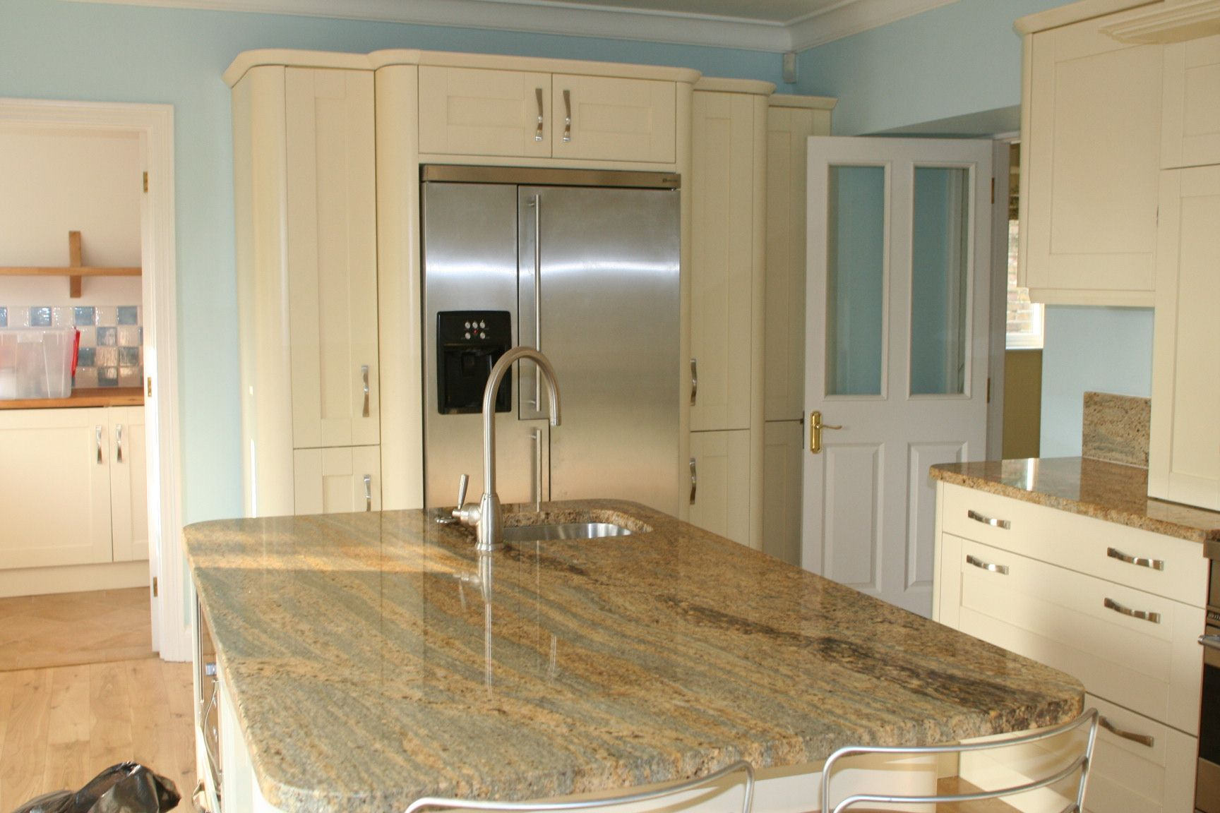 Kashmir Gold Granite And White Cabinets