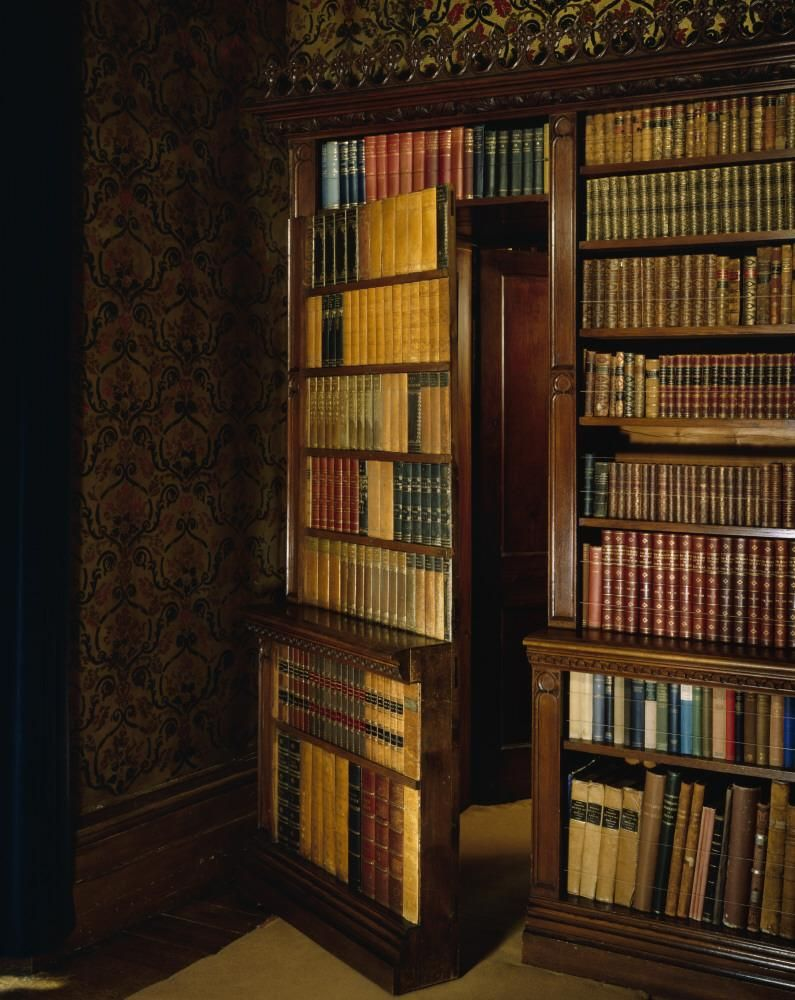 Description Oxburgh Hall The Library View Of Victorian Bookcases Showing Bookcase Door Ajar With Dummy Books Property Name Ntpl Ref
