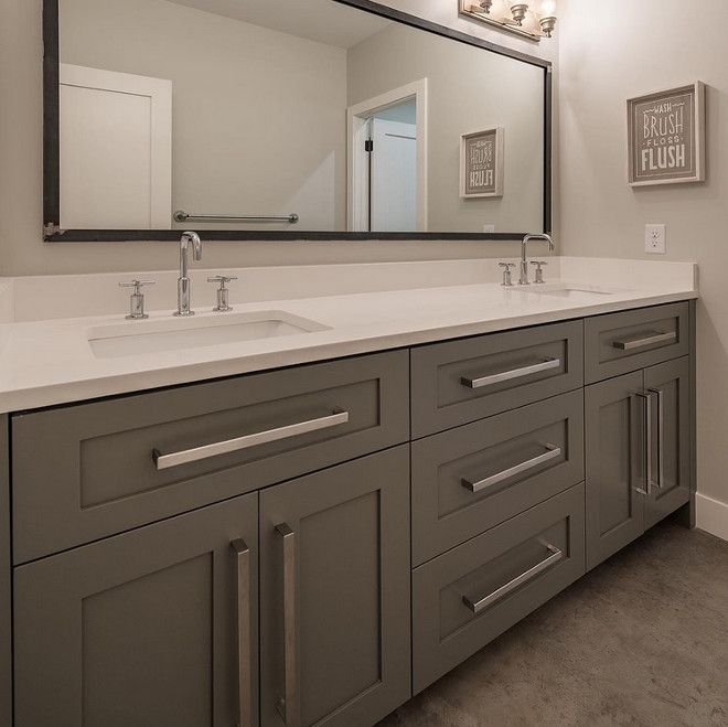 Grey Bathroom Cabinet With White Quartz Countertop And Concrete Floors. Northstar Builders, Inc