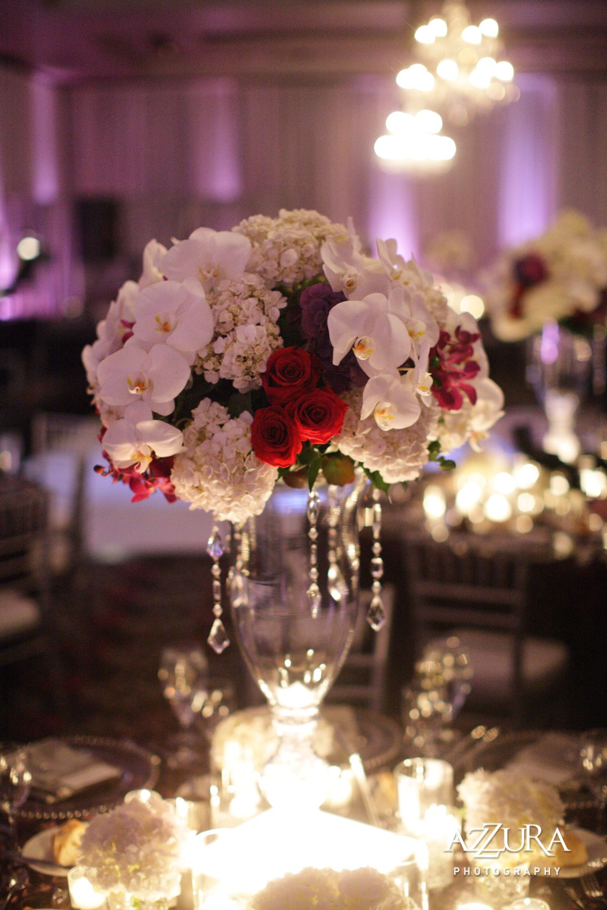 White orchid hydrangea w red rose tall centerpiece