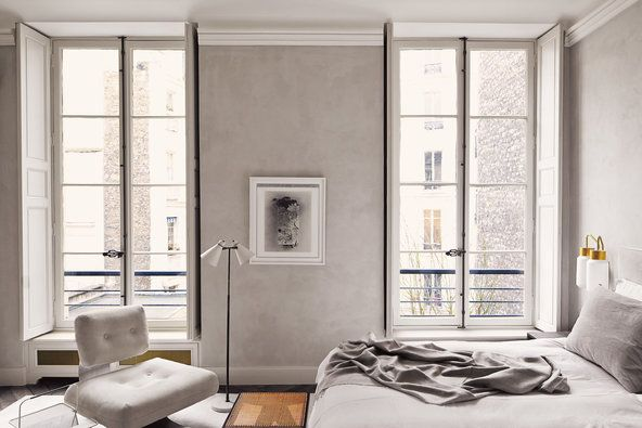 A uniform palette gives the master bedroom its tranquillity; a suede-covered Oscar Niemeyer chair sits in front of an Irving Penn photograph.