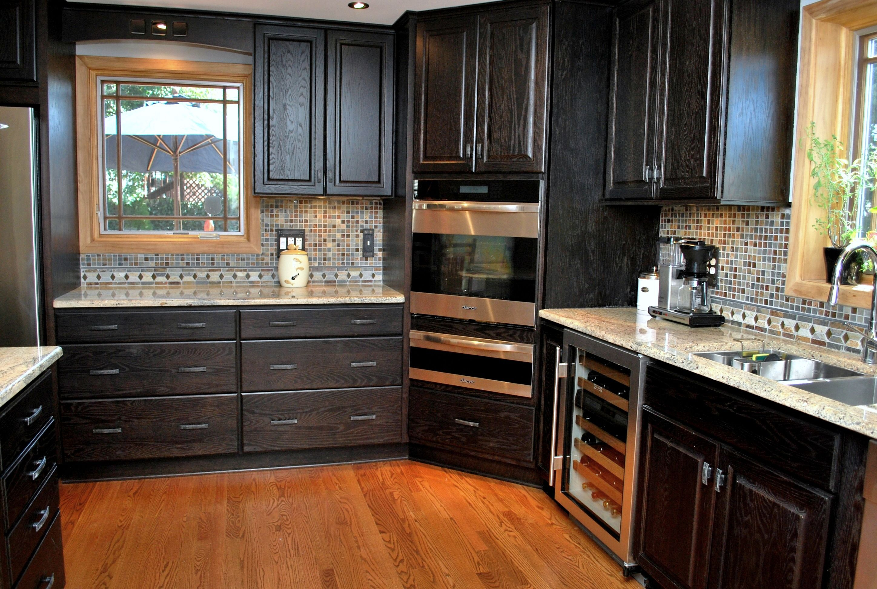 Great example of a kitchen with dark cabinetry. While this ...