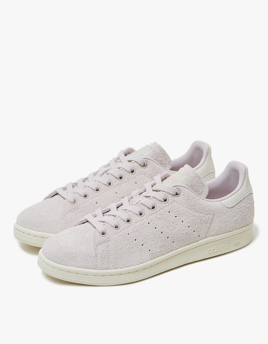 The iconic Stan Smith from Adidas in Ice Purple. Lace-up front with flat  cotton laces. Perforated at inner and outer foot. Stan Smith branding at  tongue and ...