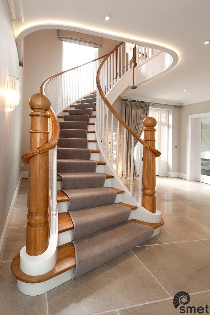 Free standing helical staircase with angled first step ...
