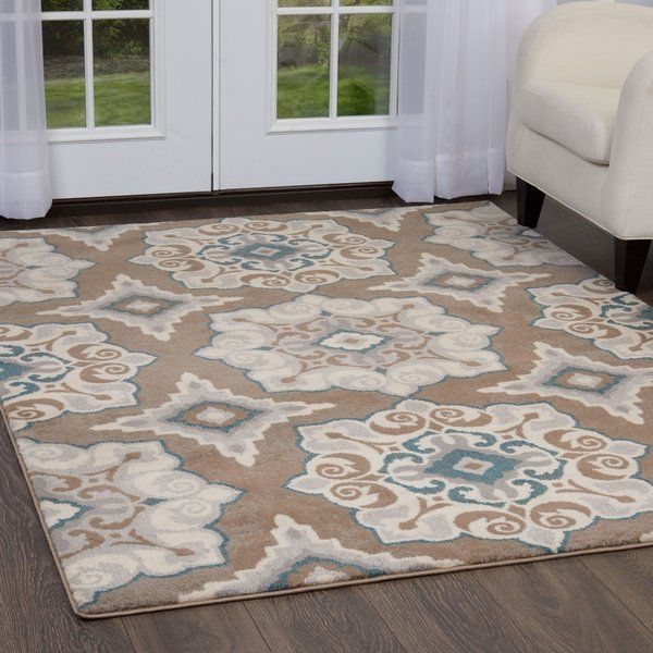 A Contemporary Update On An Eastern Inspired Design This Alluring Area Rug Showcases A Vibrant Medallion Motif In In Soft Hues Area Rugs Rugs Beige Area Rugs Taupe and blue area rug
