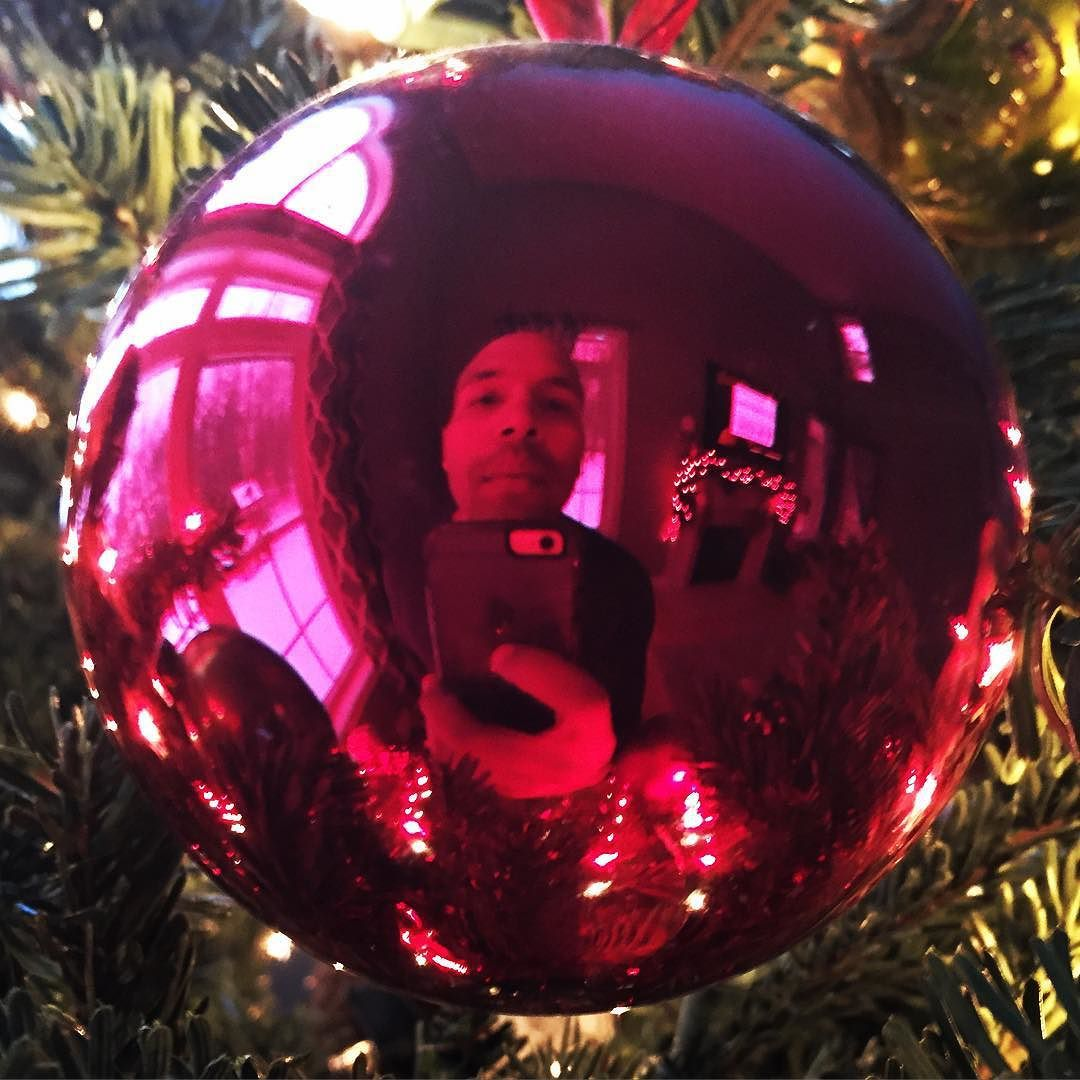 My Christmas tree is still up and I'm taking advantage of it! My wife has the same schedule every year. Tree up on #blackfriday and down Jan. 1st!  I'm already making my list for #2016.  #happyholidays #selfie #christmastree