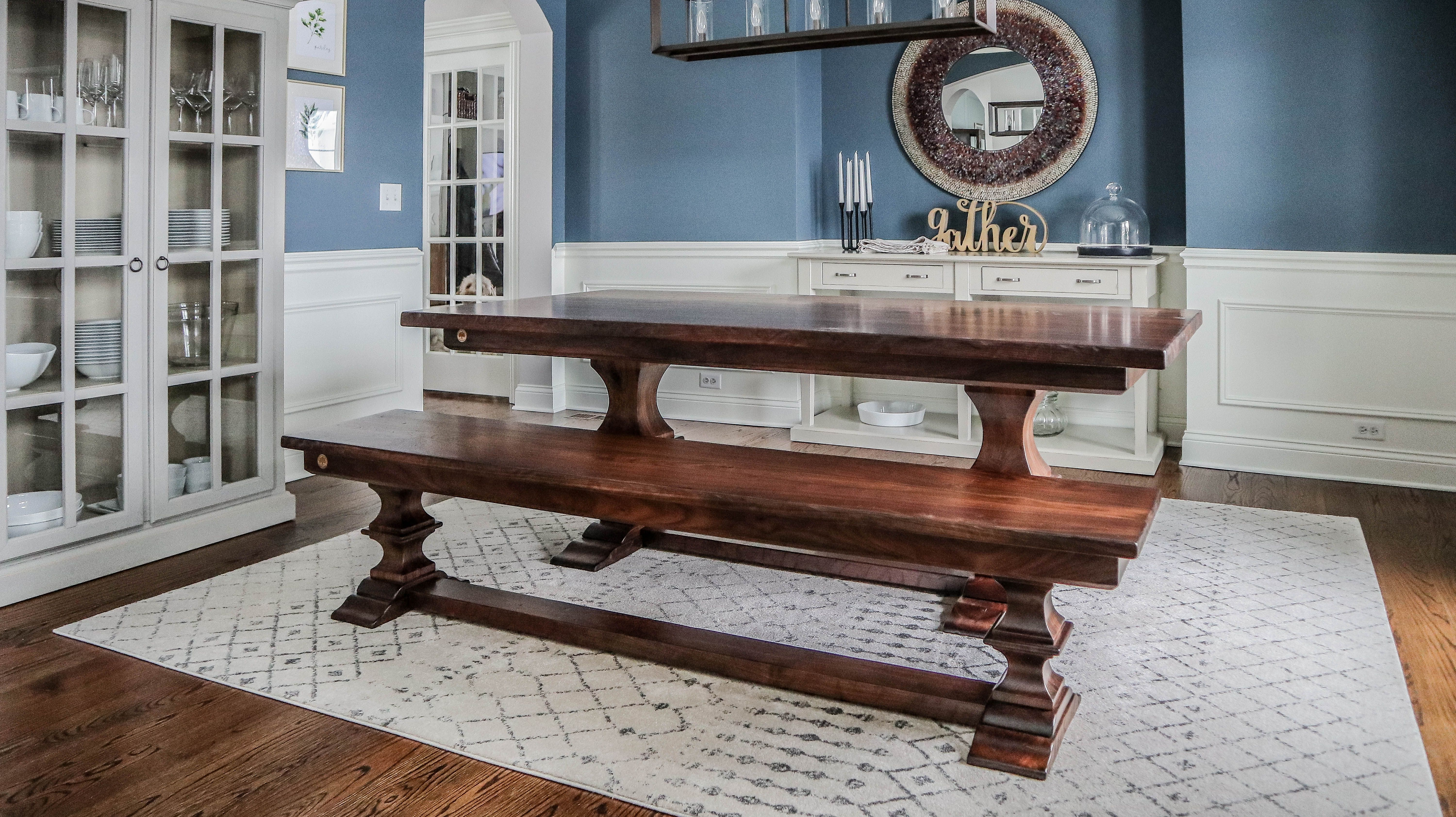 A fabulous dining room design! This is one of our ready-made tables, purchased from our showroom floor! Made from walnut, left natural, with a bench to match.  #diningroomtable #diningroomdecor #diningroomdesign #diningroominspo #tabledesign #inspo #farmhouse #farmhousecontemporary #interiordesign #interiordesignofpinterest