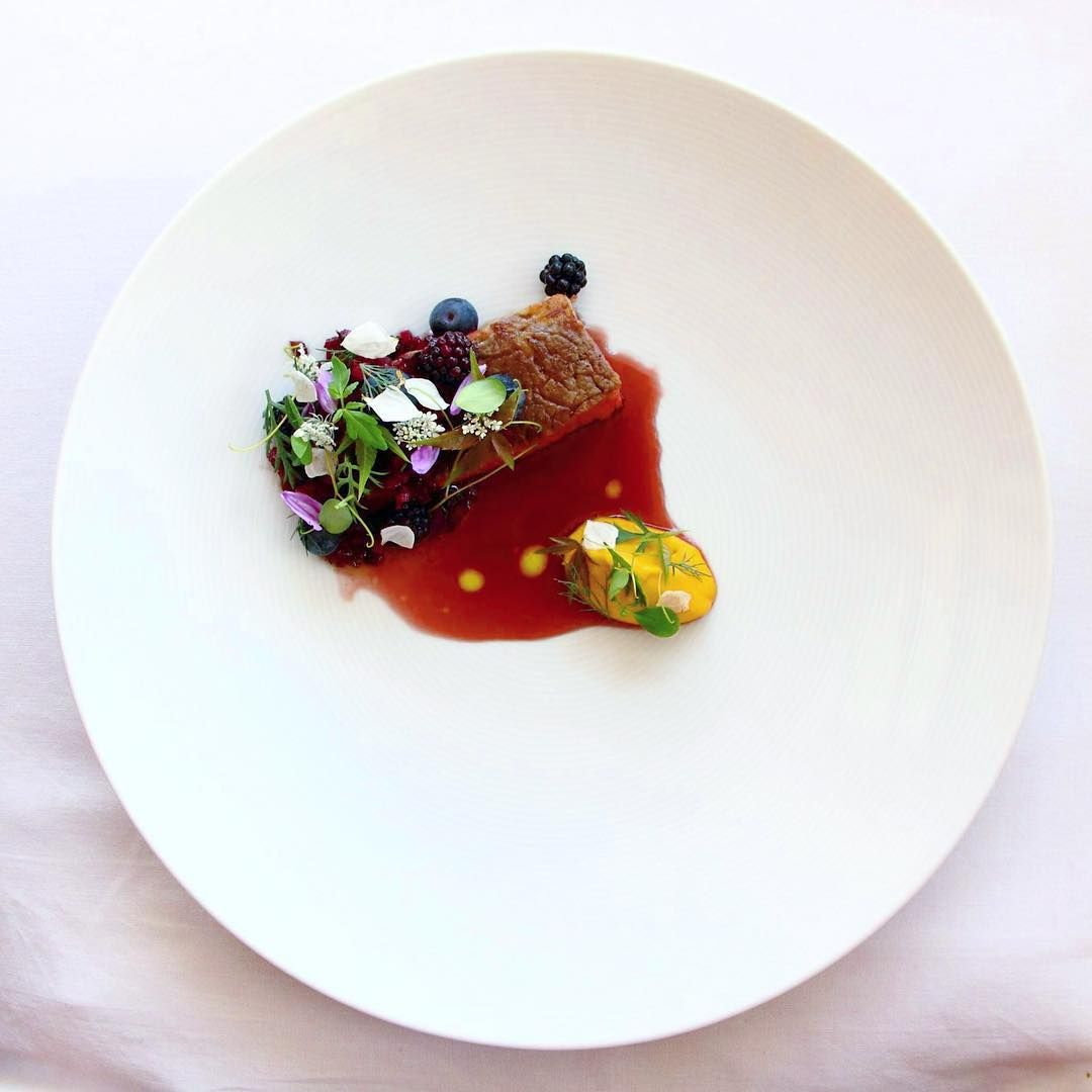 Beef antrecote, raspberry vinegar syrup, carrots and garlic cream, wild blackberries, blueberries, herbs, beetroots and plantain stems