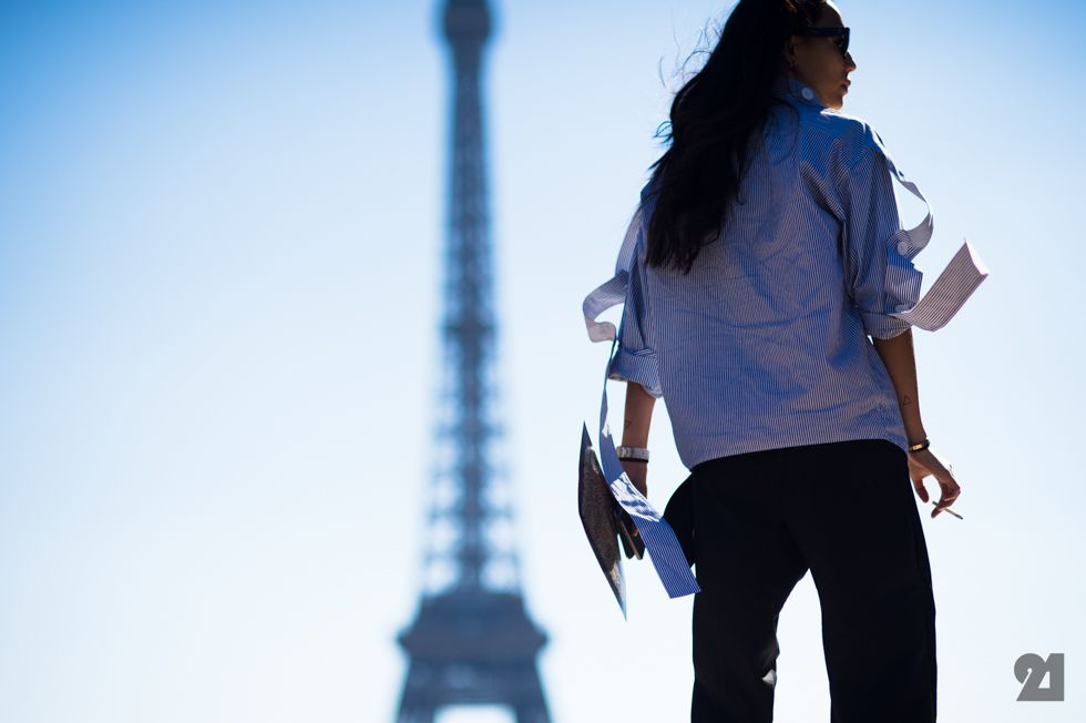 Girl in front of Eiffel tower