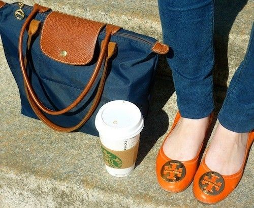 every girl's staples: longchamp, starbucks & tory burch flats.