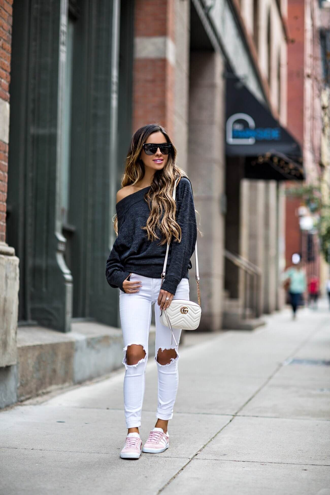 c849eaee0ba8 fashion blogger mia mia mine wearing a gray off-the-shoulder sweatshirt by  free people and pink adidas sneakers from macy s