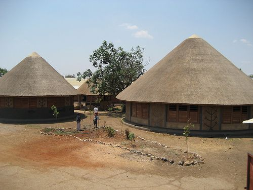 The library is actually a series of three thatched roof for African house designs